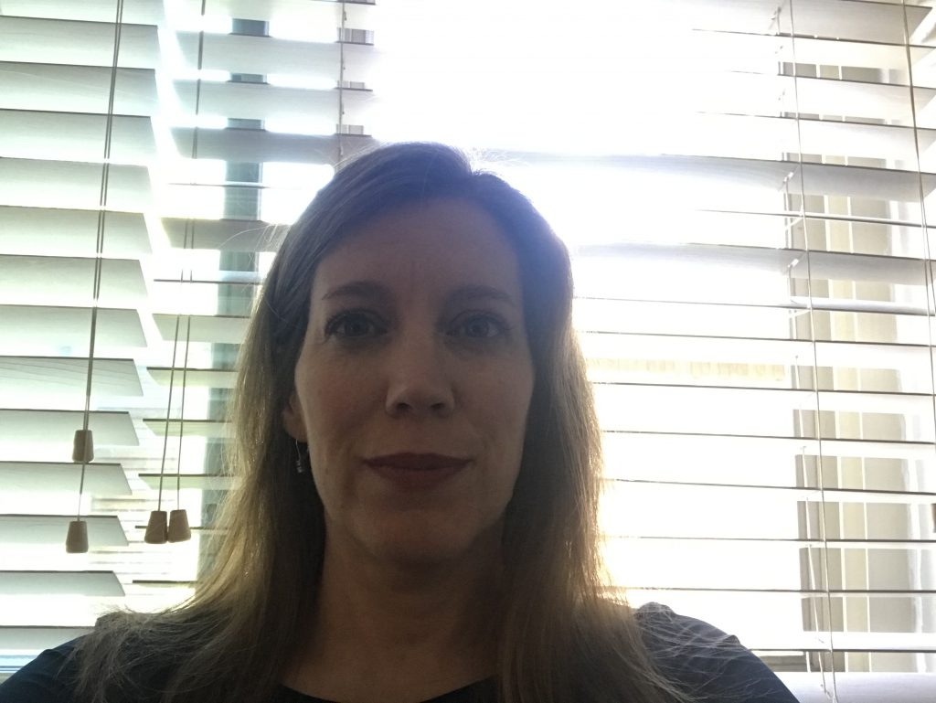 Voice and speech coach, Jenni Steck, shows what too much light behind you on a web cam does